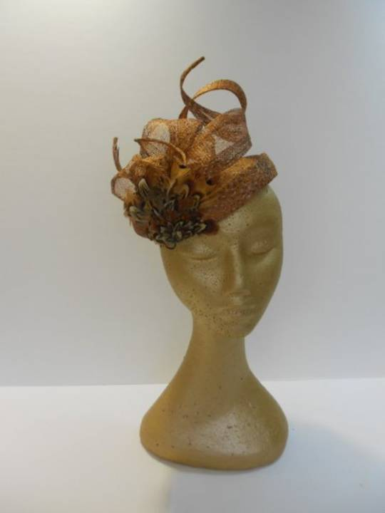 Tan half hat with twirls