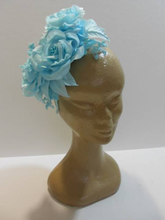 Turquoise Silk Flower Headband $295