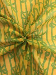 Green ribbons and stripes on mustard ground