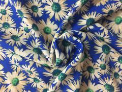 Rayon white daisies on royal blue BG