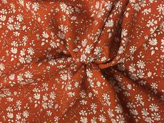 Floral print on burnt orange ground