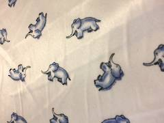 Blue elephants on off white ground