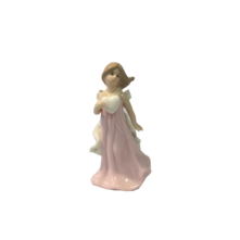 SMALL CERAMIC GIRL IN PINK HOLDING HEART