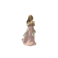 SMALL CERAMIC GIRL IN PINK HOLDING DOVE