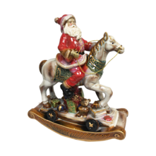 RUSTIC CERAMIC SANTA RIDING ROCKING HORSE