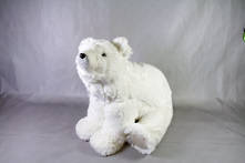 LARGE FURRY WHITE POLAR BEAR SITTING