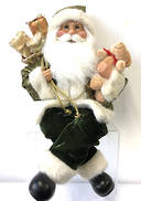 40CMH SITTING SANTA IN GREEN/BEIGE HOLDING A BEAR AND GIFT BAG