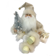 30CMH SITTING SANTA IN IVORY HOLDING GIFT BOXES AND A TREE