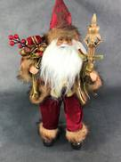 30CMH SITTING SANTA IN BURGUNDY GOLD HOLDING SCEPTER AND GIFT
