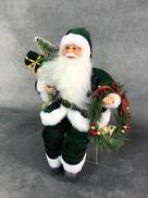 30CMH SITTING SANTA IN GREEN WHITE HOLDING A WREATH AND GIFT
