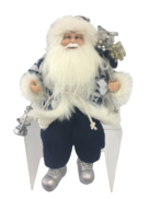 30CM SITTING SANTA IN BLUE WHITE HOLDING LANTERN AND GIFT BA