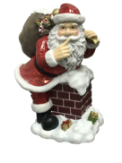 RESIN SANTA GOING DOWN CHIMNEY