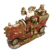 RUSTIC CERAMIC SANTA IN CAR