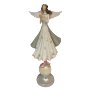 WHITE PINK ANGEL STANDING ON BALL