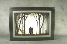 FAMILY IN WOODS LIGHT UP SCENE