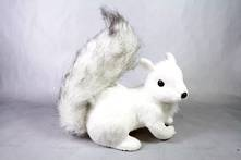 CROUCHING SQUIRREL WITH BUSHY TAIL
