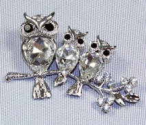 DOZEN SILVER DIAMANTE OWLS ON BRANCH HANGERS