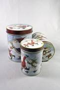 SET3 ROUND TINS WITH SKATING SANTA DESIGN (2)