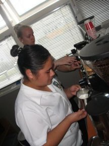 Naomi and Courtney making fair trade coffee