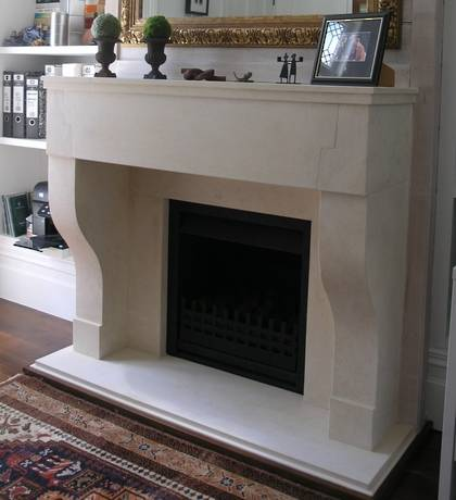 18th Century French mantle design, carved in Oamaru Limestone with aged patina