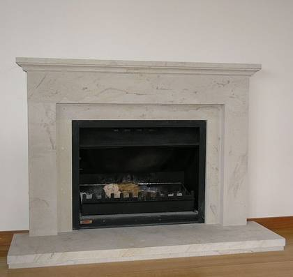 Classical linear styling with Tuscan moulding to mantle carved in Hinuera Stone