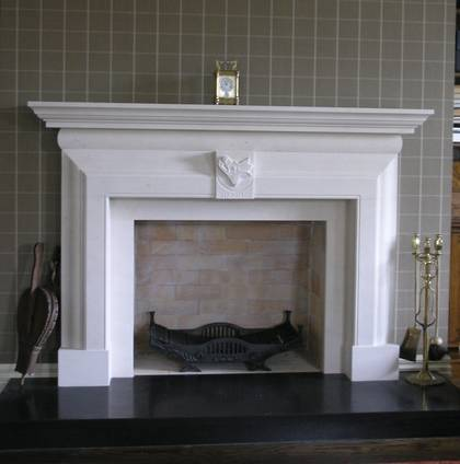 Classical 18th Century Georgian design fireplace, with Spooners' Boars Head Coat of Arms detail, carved in Portuguese Limestone