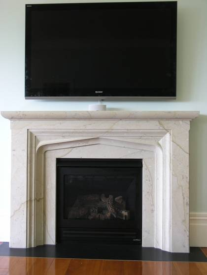 Classical Jacobean style fireplace, carved in Hinuera stone with Bluestone hearth