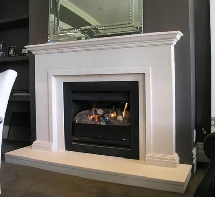 Classical fire surround with trim to internal edge, carved in Portuguese Limestone