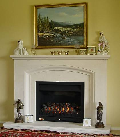 Classical radius arch style fire surround carved in Portuguese Limestone