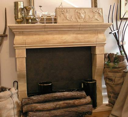 XV11C French fireplace design carved in Oamaru Limstone with Aged Patina