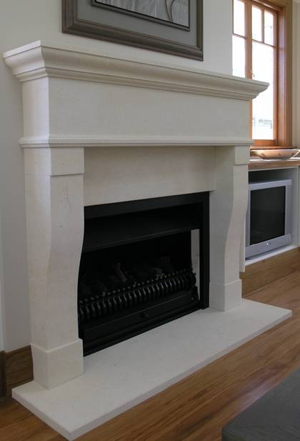 Moderately sized French Provincial designed fireplace, hand carved in Oamaru Limestone