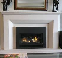 Contemporary designed fireplace with bevel to internal edge, carved in Portuguese Limestone