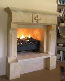 French 'Gothique 'fireplace mantle with Honeybourne Family crest carved detail, carved in Oamaru Limestone with aged patina