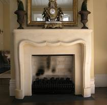 French Louis XIV style fire surround hand carved in Oamaru stone with aged patina wash