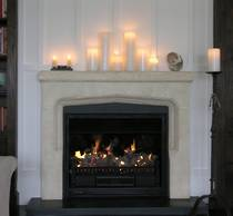Larger Arts and Crafts fireplace mantle carved in Oamaru Limestone with aged patina and Bluestone hearth