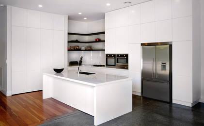 Villa kitchen is light + white in Mt Eden