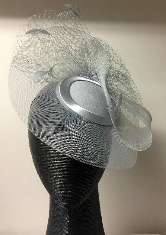 Silver cocktail hat with veiling and feathers