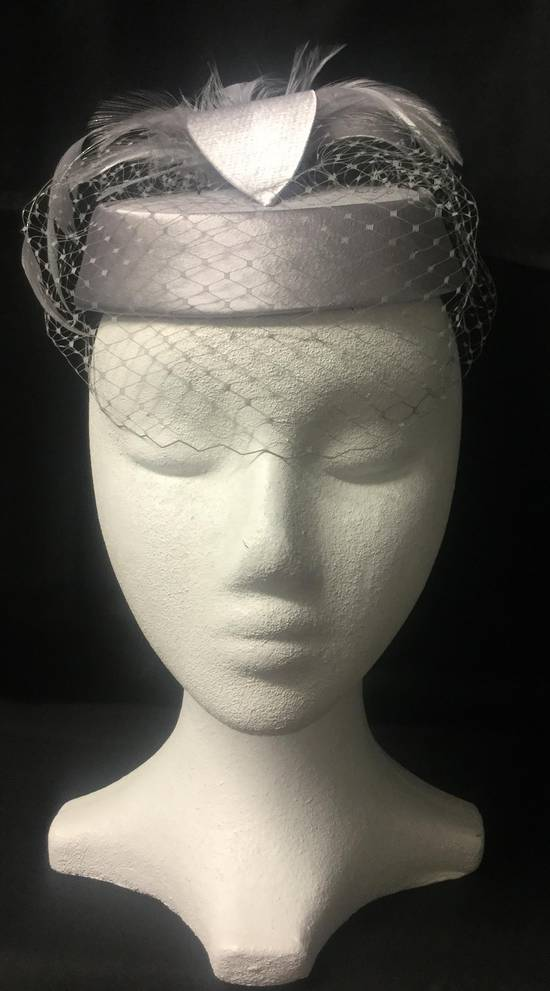 Silver pillbox hat with veiling - one only