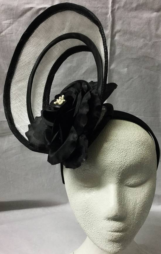 White and black fascinator with cut aways and flower - one only