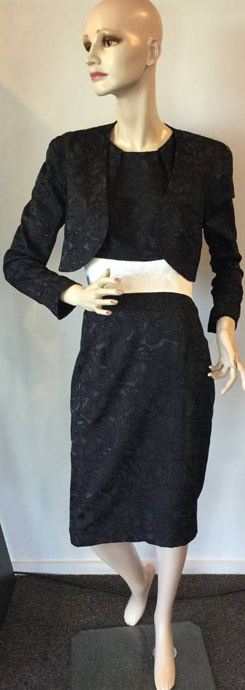 Black dress with a contrasting white waist band - one only size 12