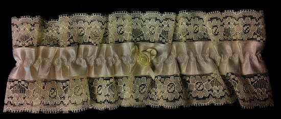 cream satin garter edged in lace with one flower