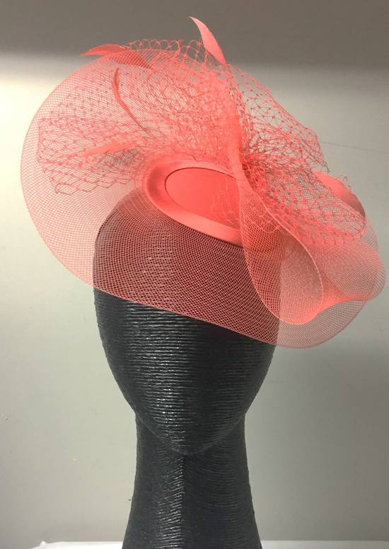Coral cocktail hat with veiling and feathers
