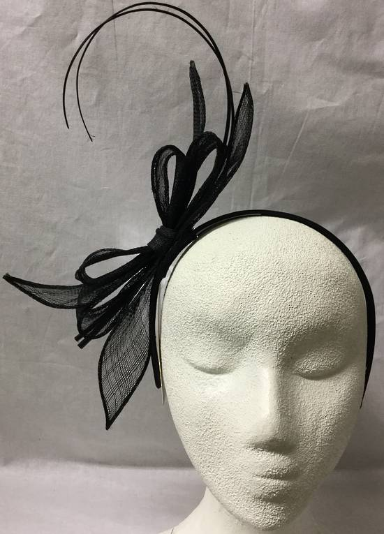 Black fascinator with bows and curly sticks
