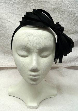 Black fascinator with black jet rose