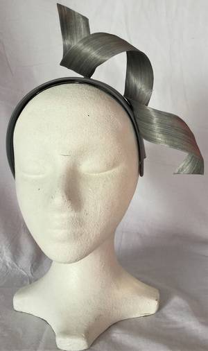 Silver twist fascinator on a headband - one only