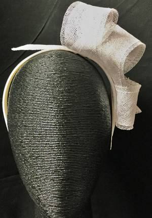 White looped fascinator on a headband - one only