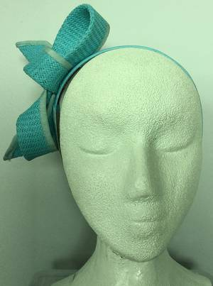 Turquoise looped fascinator on headband - one only
