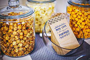 Caramel Popcorn in glass jars at a party