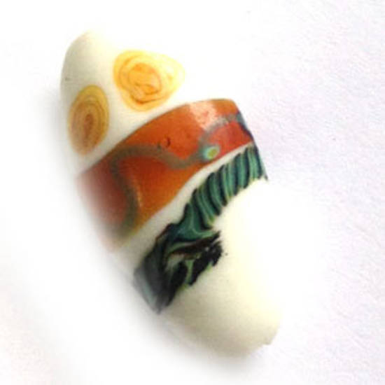 Chinese lampwork oval, white with tribal type markings