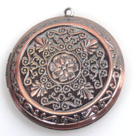 Large copper coloured medallion locket